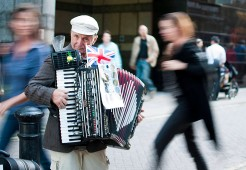 A Russian immigrant plays the accordion near the Millennium Bridge in London, England.