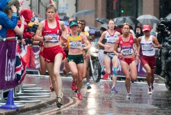 Marathon runners race through the rain in front of St. Paul's Cathedral in London.