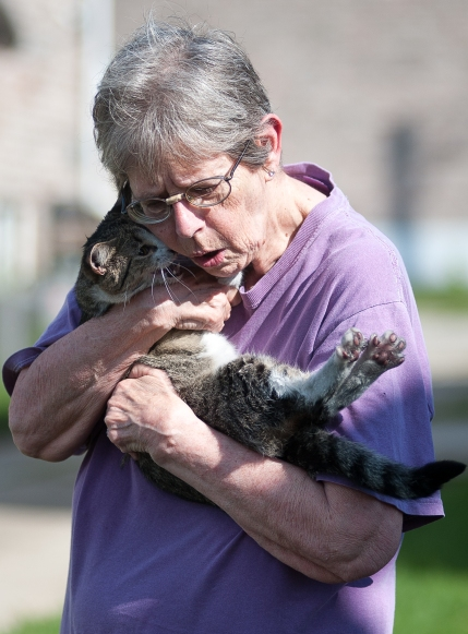 Susan Knox hugs her cat, Aria, after it was revived by firefighters after being pulled from the fire at 304 Sequoyah Trail. © Bobby Ellis