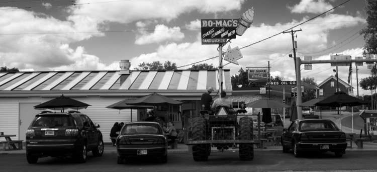 Two boys sit on a tractor at the local fast food joint in Shoals, Ind.