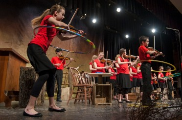 Fiddle players perform during the Apple Corps spring concert.