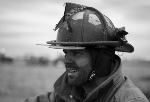 A firefighter takes a break while fighting a field fire near Union, Neb.