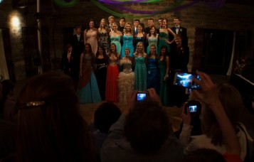 Lourdes High School prom goers get their photo taken after the grand march.